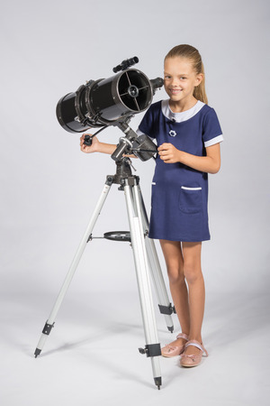 ufology: The young astronomer sets up a telescope and looked into the frame Stock Photo