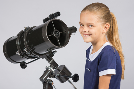 ufology: The young astronomer at the telescope is smiling and looking to the frame