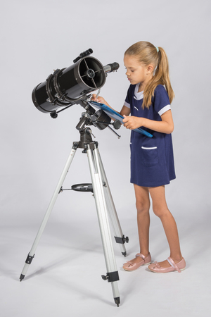 The astronomer carefully recorded observations on a sheet of paper Stock Photo