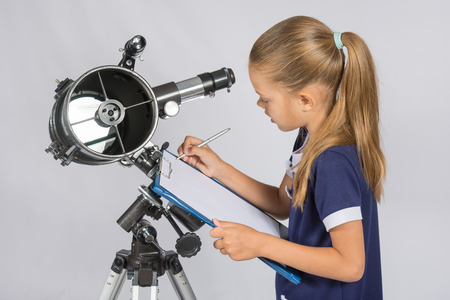 observations: Astronomer writes observations Stock Photo