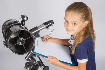 observations: Young Astronomer writes the results of observations in the document