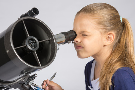 an eyepiece: The young astronomer looks through the eyepiece of the telescope and record results