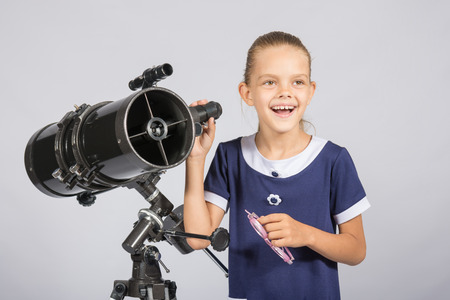 ufology: The young astronomer happily standing on the starry sky