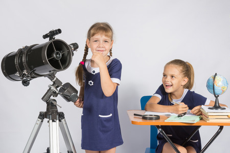 astronomer: Girl astronomer thought, another girl with a smile looking at her Stock Photo