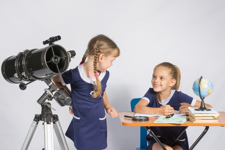 looked: The two girls looked at each other in the classroom Astronomy