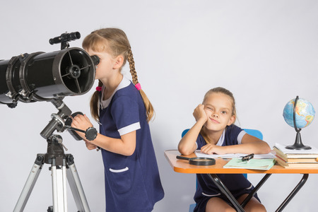 expects: A girl looks through a telescope, the other girl is waiting sad results
