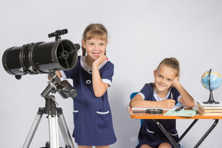 expects: Two girls mysteriously astronomers thinking Stock Photo