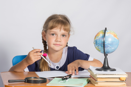 geography: Schoolgirl on geography lesson