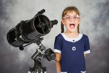 astronomer: Girl astronomer happily surprised by what he saw in the telescope