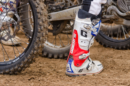 off road racing: Volgograd, Russia - April 19, 2015: Racing Boot motorcycle racer at the wheel background, at the stage of the Open Championship Motorcycle Cross Country Cup Volgograd Region Governor Editorial