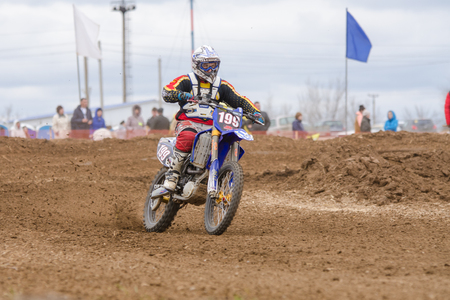 off road racing: Volgograd, Russia - April 19, 2015: Motorcycle racer riding on dirt track, at the stage of the Open Championship Motorcycle Cross Country Cup Volgograd Region Governor