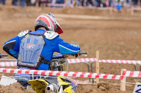 governor: Volgograd, Russia - April 19, 2015: Motorcycle racer is ready to take the start in the race to stage the Open Championship Motorcycle Cross Country Cup Volgograd Region Governor