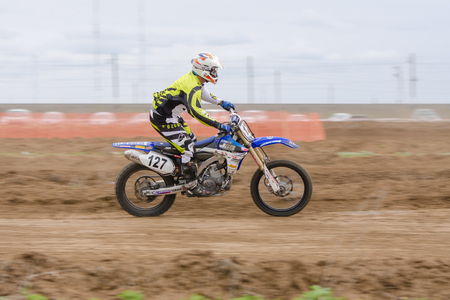 governor: Volgograd, Russia - April 19, 2015: Motorcycle racer racing on dirt track, at the stage of the Open Championship Motorcycle Cross Country Cup Volgograd Region Governor Editorial