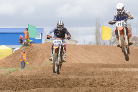 governor: Volgograd, Russia - April 19, 2015: Two riders on the track, at the stage of the Open Championship Motorcycle Cross Country Cup Volgograd Region Governor