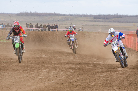 governor: Volgograd, Russia - April 19, 2015: Three riders on the track, at the stage of the Open Championship Motorcycle Cross Country Cup Volgograd Region Governor