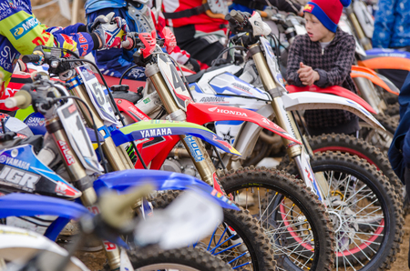 start to cross: Volgograd, Russia - April 19, 2015: close-up of motorcycles at the start of the competition, at the stage of the Open Championship Motorcycle Cross Country Cup Volgograd Region Governor