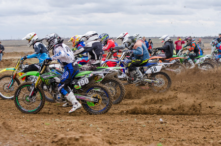 start to cross: Volgograd, Russia - April 19, 2015: Motorcycle racer took the race start, at the stage of the Open Championship Motorcycle Cross Country Cup Volgograd Region Governor