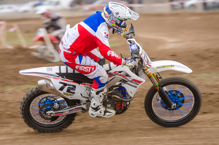 Volgograd, Russia - April 19, 2015: Motorcycle racer racing on dirt track, at the stage of the Open Championship Motorcycle Cross Country Cup Volgograd Region Governor Editorial