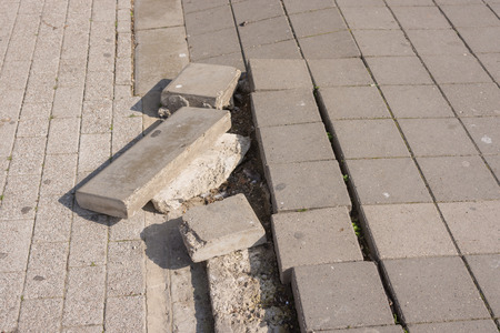 earthquake crack: Deplete the joint from different bruschatok on the pedestrian mall Stock Photo
