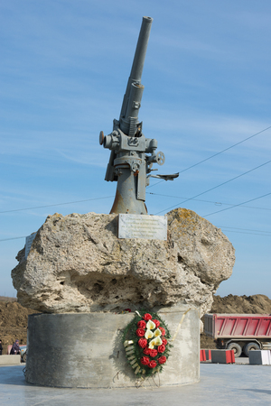 Taman, Russia - March 8, 2016: View of the monument to the Soviet paratroopers in the Tuzla Spit - Lender gun with armored BKA 73 Azov flotilla Black Sea Fleet, who died 11.02.1943 in Kerch-Eltigen Operation