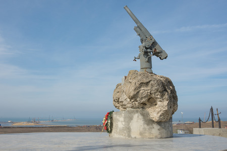 tuzla: Taman, Russia - March 8, 2016: A monument to Soviet paratroopers in the Tuzla Spit - Lender gun with armored BKA 73 Azov flotilla Black Sea Fleet, who died 02.11.1943 in Kerch-Eltigen Operation Editorial