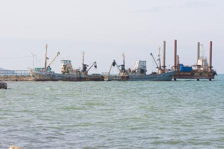 taman: Taman, Russia - March 8, 2016: two fishing trawlers are berthed