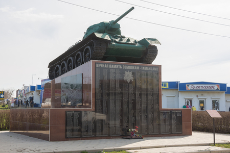 invaders: Taman, Russia - March 8, 2016: The monument in the form of a T-34 tank on a pedestal, established in honor of the Soviet soldiers who took part in the liberation from Nazi invaders Taman