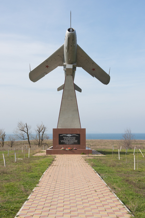 invaders: Taman, Russia - March 8, 2016: The memorial stele in the form of an airplane taking off, in honor of aviators soldiers, members of the battles for the liberation of the Taman Peninsula from Nazi invaders 1942-1943 g