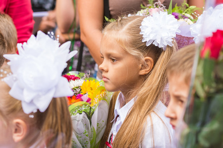 First grader standing in a crowd of children on line the first of September Imagens