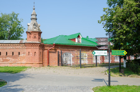 Sergiev Posad - August 10, 2015: the intersection with the pointer in the red wall extending from retail shops around Pafnutevskom garden at the Trinity-Sergius Lavra