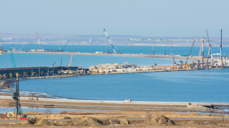 Taman, Russia - November 5, 2016: Construction of a bridge across the Kerch Strait, a view of the coastline and the connection Tuzla Spit from the Taman Peninsula, as of November 2016