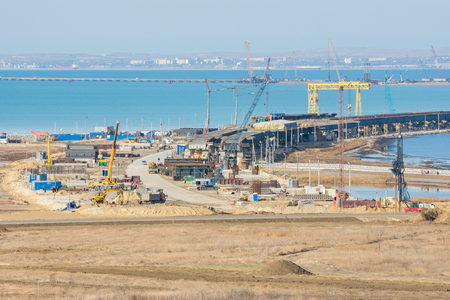 Taman, Russia - November 5, 2016: Construction of a bridge across the Kerch Strait, a view of the top of the bridge from the Taman Peninsula, as of November 2016