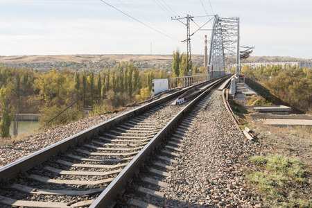 embankment: Rails running on a railway bridge across the Volga-Don canal, Volgograd
