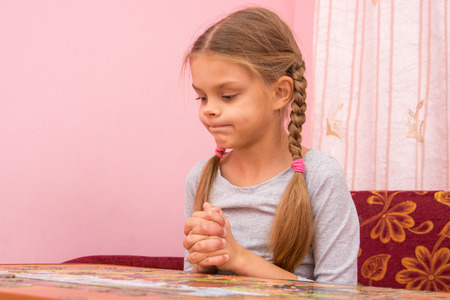 Girl funny thought pouting cheeks collecting picture of puzzles