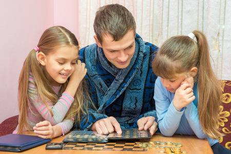 numismatist: Pope shows children his collection of coins Stock Photo