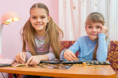numismatist: Two children are considered a collection of coins in albums