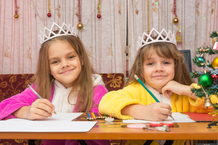 treasured: Two girls write wishes for the new year