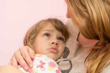 Mom comforting five-year daughter