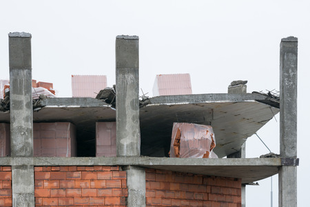 noncompliance: The collapse of the floor slab in the construction of the house Stock Photo