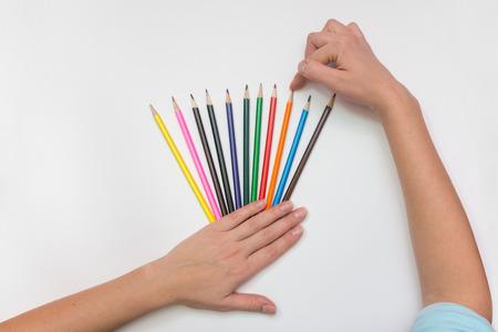 She chooses the correct pencil, close-up top