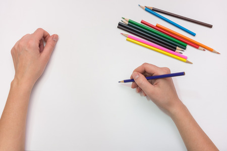 vocational training: Female hand painted with colored pencils on paper, close-up Stock Photo