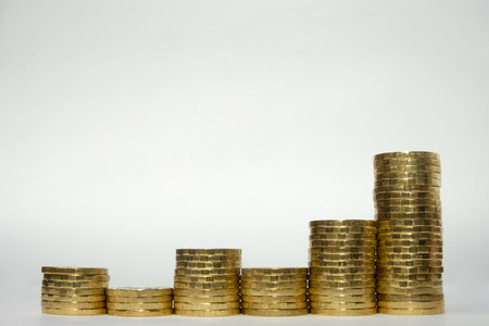 Six stacks of coins showing uneven growth of profitability