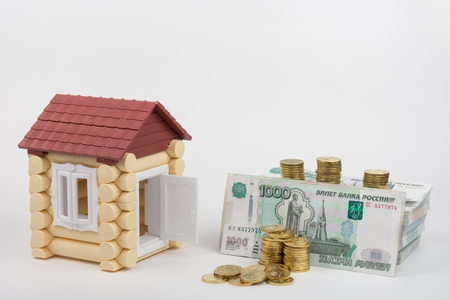 overhaul: Next to the house are a toy money to pay for housing and communal services and overhaul Stock Photo