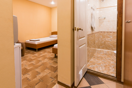 The interior of the small room, the entrance to the room and bathroom Foto de archivo
