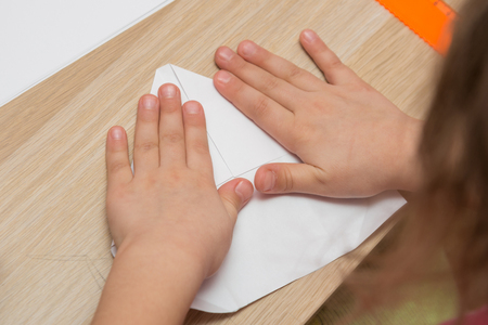 adds: Girl is engaged in origami, make a paper airplane
