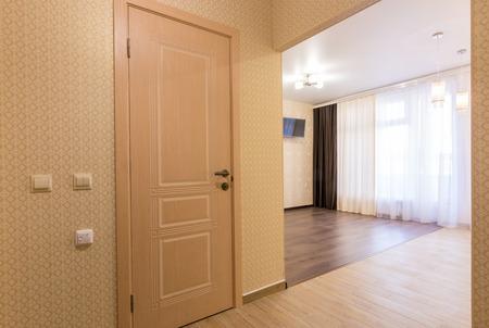 budget repair: Interior studio, view from the front door to the room and the bathroom door