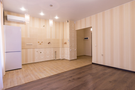 sold small: Interior of studio apartment, entrance to room and kitchen without a headset