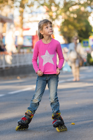 Six-year-old girl roller-skating