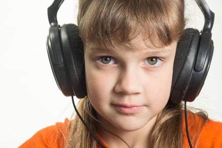 Portrait of a purposeful girl with headphones