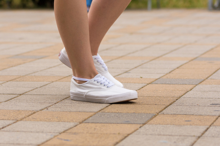Female sneakers are dressed for a girl, close-up